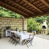 Überdachte Terrasse mit Grill im Ferienhaus Cascina Monferrato