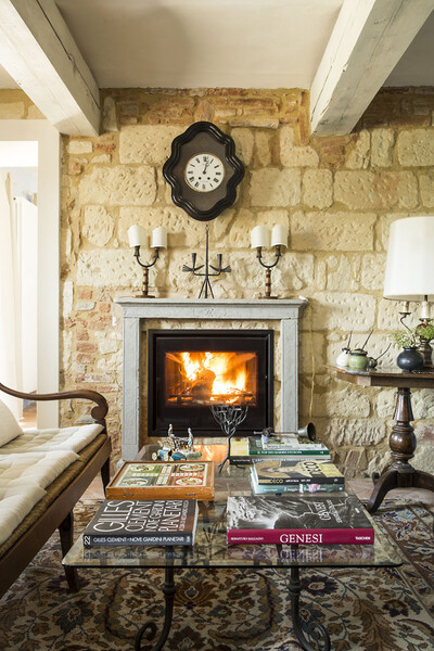 Open fireplace in the livingroom of the holiday home Cascina Monferrato