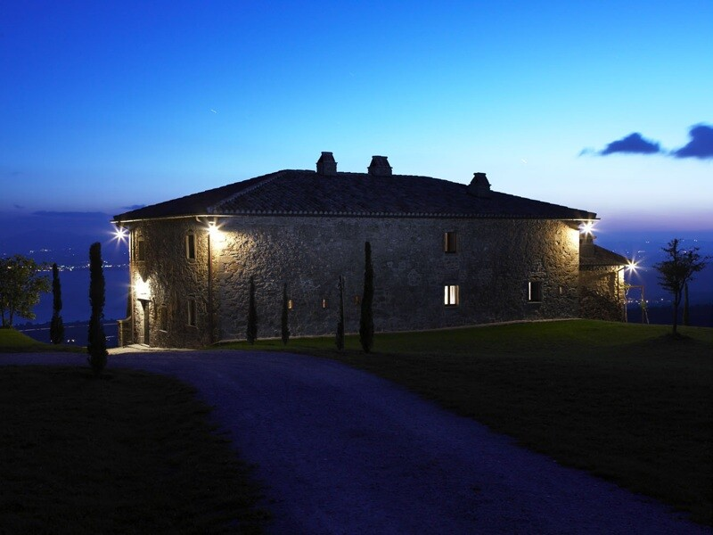 Casa Bramasole by night with view over the Trasimeno Lake